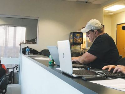 Tony Eierdam is shown in the Bearcat Stadium press box before a game early in the 2019 season.