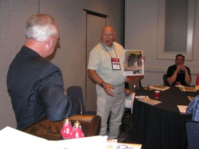 John Galer (right) shares a special section he ran at The Journal-News in Hillsboro, Illinois, at the Great Idea Exchange as part of the 130th Annual Convention & Trade Show in Franklin, Tennessee, moderated by Robert Williams Jr. (left). (Publishers  Auxiliary)